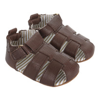 Brown leather baby sandals with soft soles and adjustable strap.