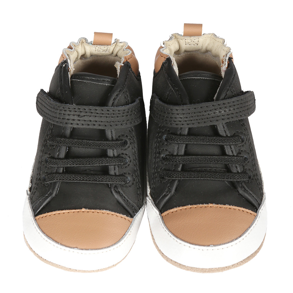Black leather high-top baby shoe inspired by high-top sneakers.