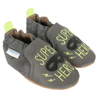 "Grey leather baby shoes for boys featuring a mask and the words ""SUPER HERO""."