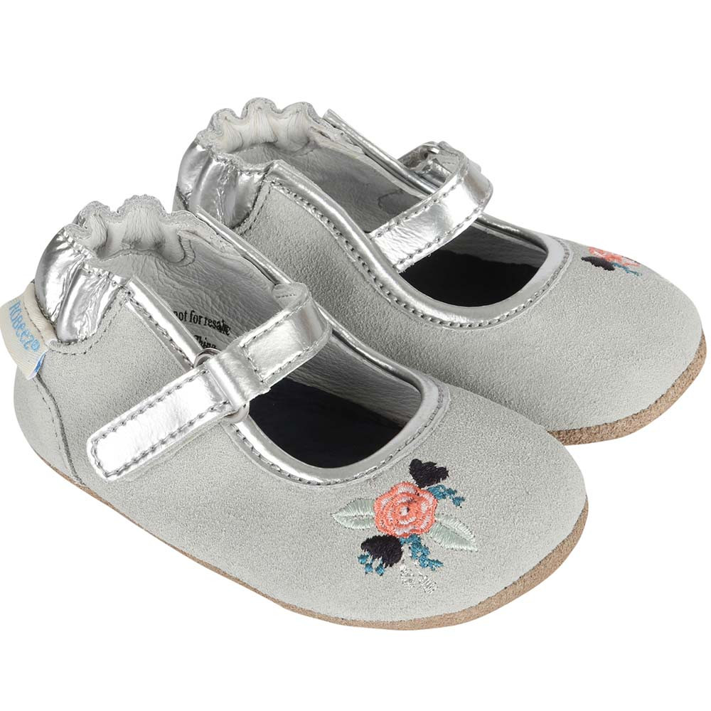 Girls baby shoes in grey suede with flower embroidery and silver leather details.