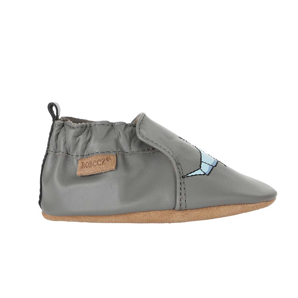 Single side view of Shark-tastic Baby Shoes, a grey leather soft soled crib shoe for boys and girls that feature sharks.
