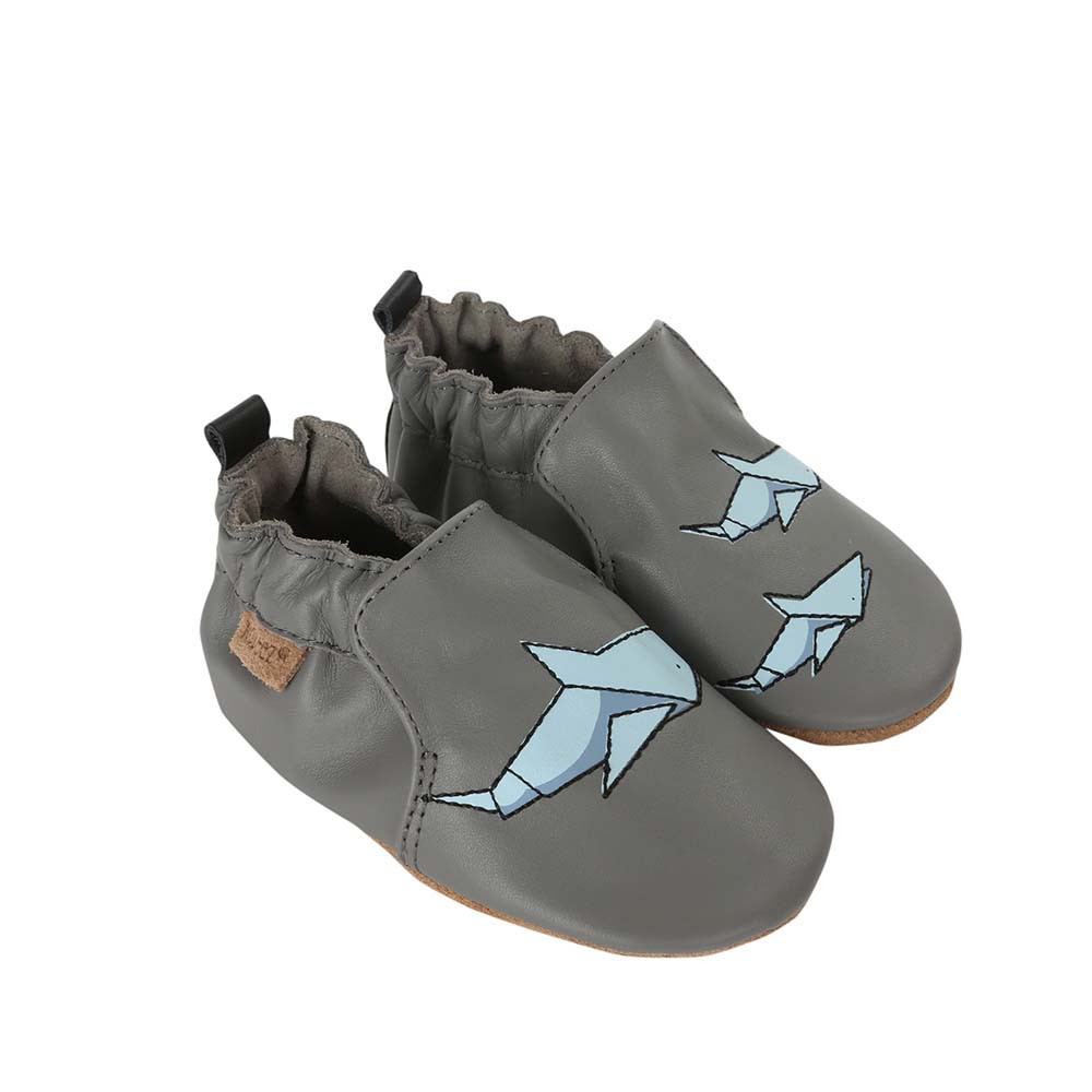 Side view of Shark-tastic Baby Shoes, a grey leather soft soled crib shoe for boys and girls that feature sharks.