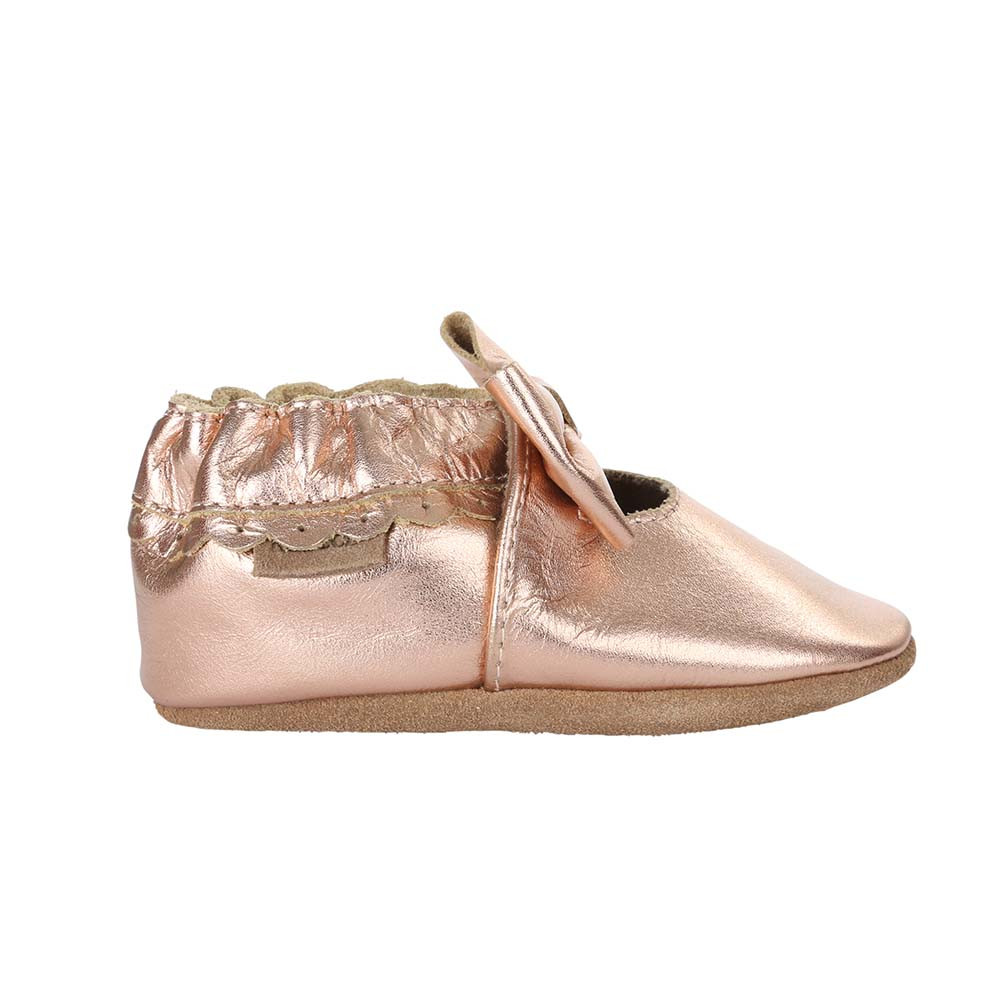 Single side view of Rosie Moccasin in rose gold, a soft soled baby moccasin for girls ages 0 - 24 months.