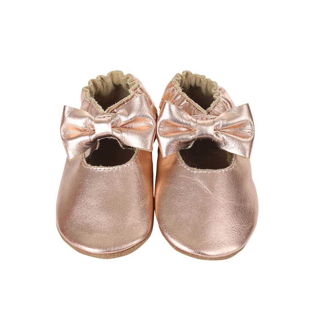 Front view of Rosie Moccasin in rose gold, a soft soled baby moccasin for girls ages 0 - 24 months.