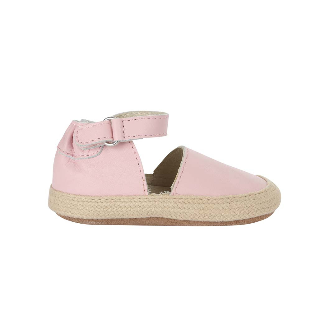 Single side view of Kelly Espadrille Baby Shoe, a girl's crib shoe in pink leather with a soft sole.