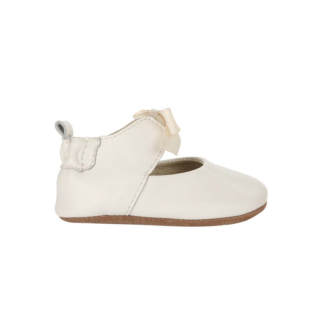 Single Side view of Adeline Ankle Strap Baby Shoe, a soft soled crib shoe for girls in white leather.