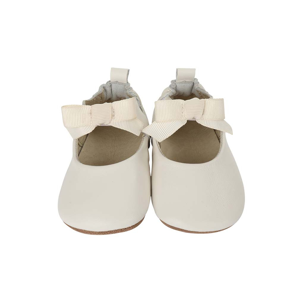 Front view of Adeline Ankle Strap Baby Shoe, a soft soled crib shoe for girls in white leather.