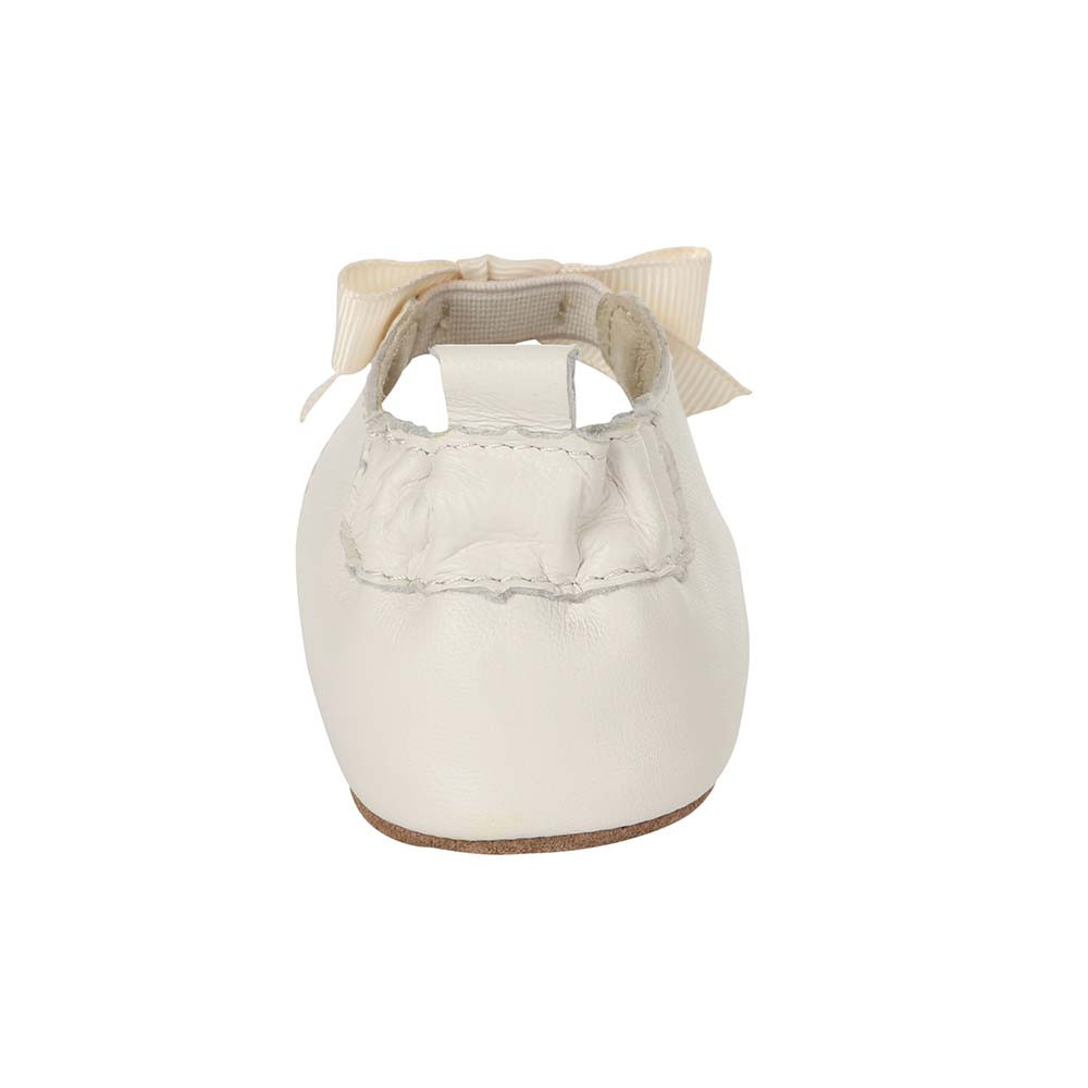 Back view of Adeline Ankle Strap Baby Shoe, a soft soled crib shoe for girls in white leather.