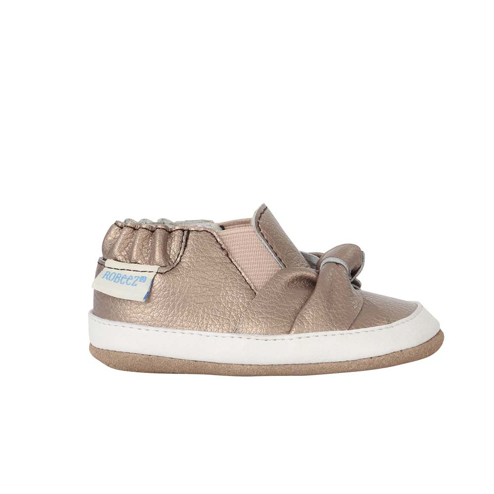 Single side view of  Bella's Bow baby shoes, children shoes for baby, infant and toddler girls ages 3 - 24 months. Bronze leather shoes with soft soles and rubber outer sole.