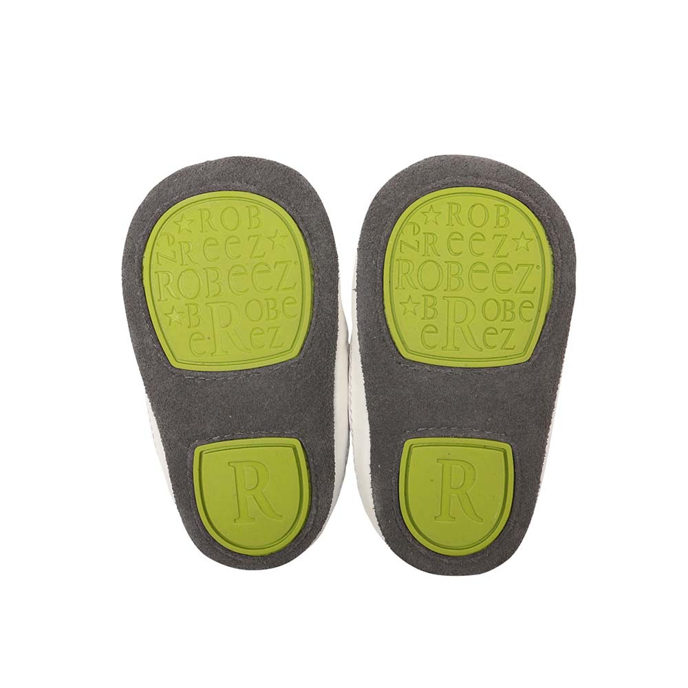 Sole of Zachary High Top Baby Shoes, a soft sole with rubber outer sole to provide additional protection and support for early walkers.