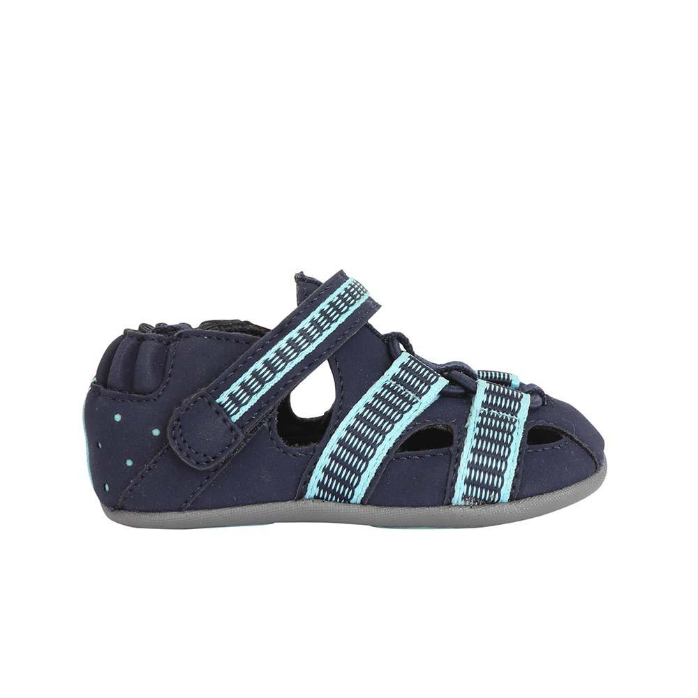 Single side view of Navy Beach Break Baby Shoe, a baby sandal in PU designed to look like a beach sandal.