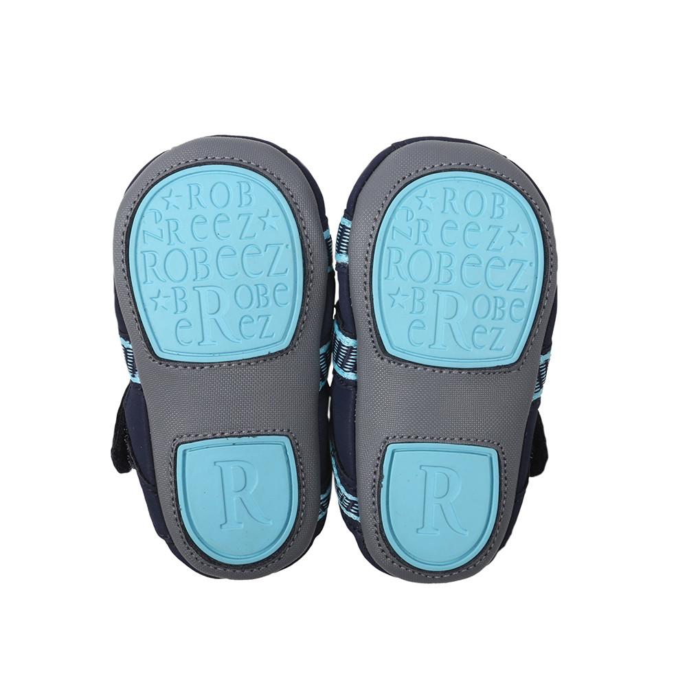 Sole of Navy Beach Break Baby Shoe, a split rubber sole with suede sole.