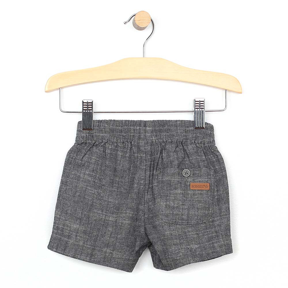 Grey woven shorts with elastic waste and faux drawstring for baby and toddler boys. Back view.