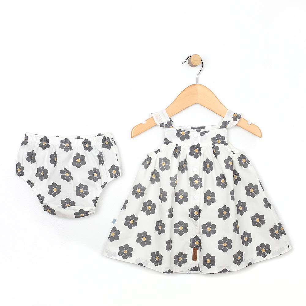 White cotton dress with grey and yellow flowers for baby and toddler girls.  With Diaper Cover. Back View.
