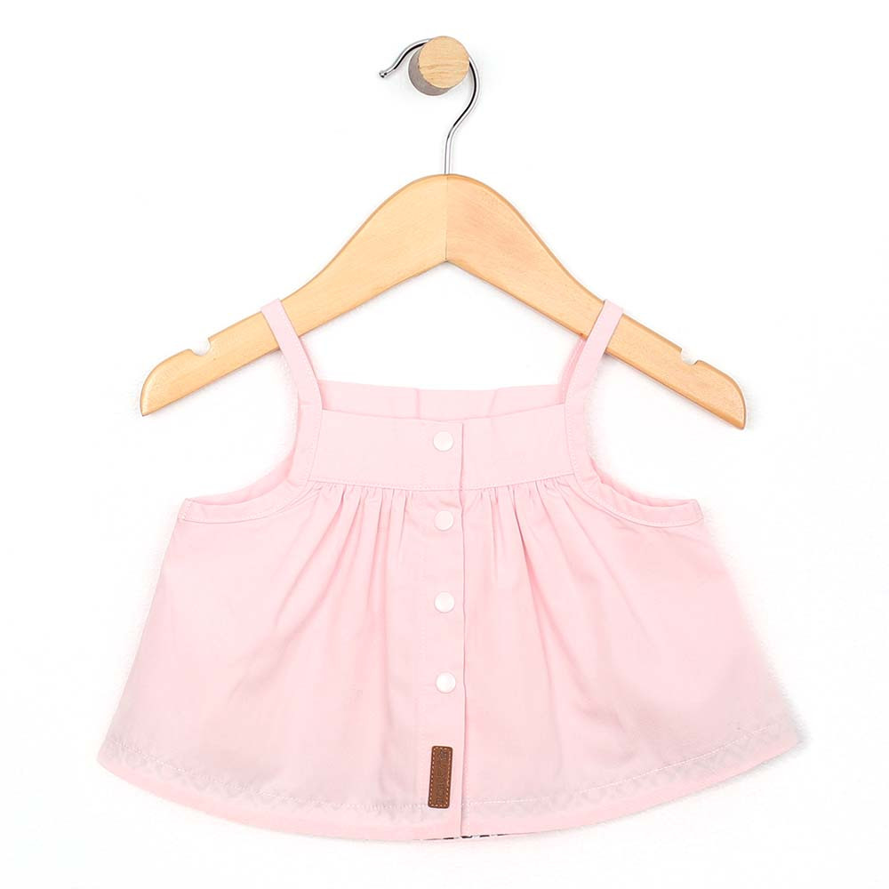 Back view of baby and toddler girl top in pink cotton.