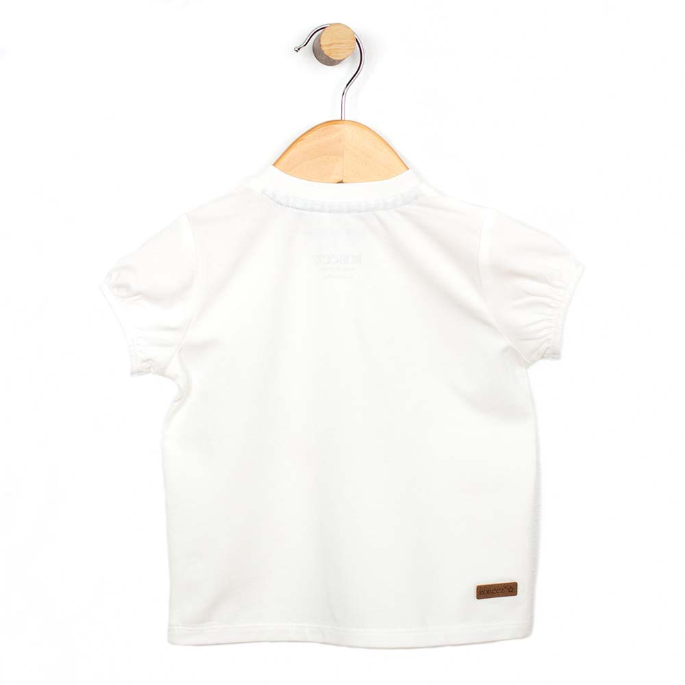 Back view of a white cotton shirt for baby and infant girls.  Features a bird.
