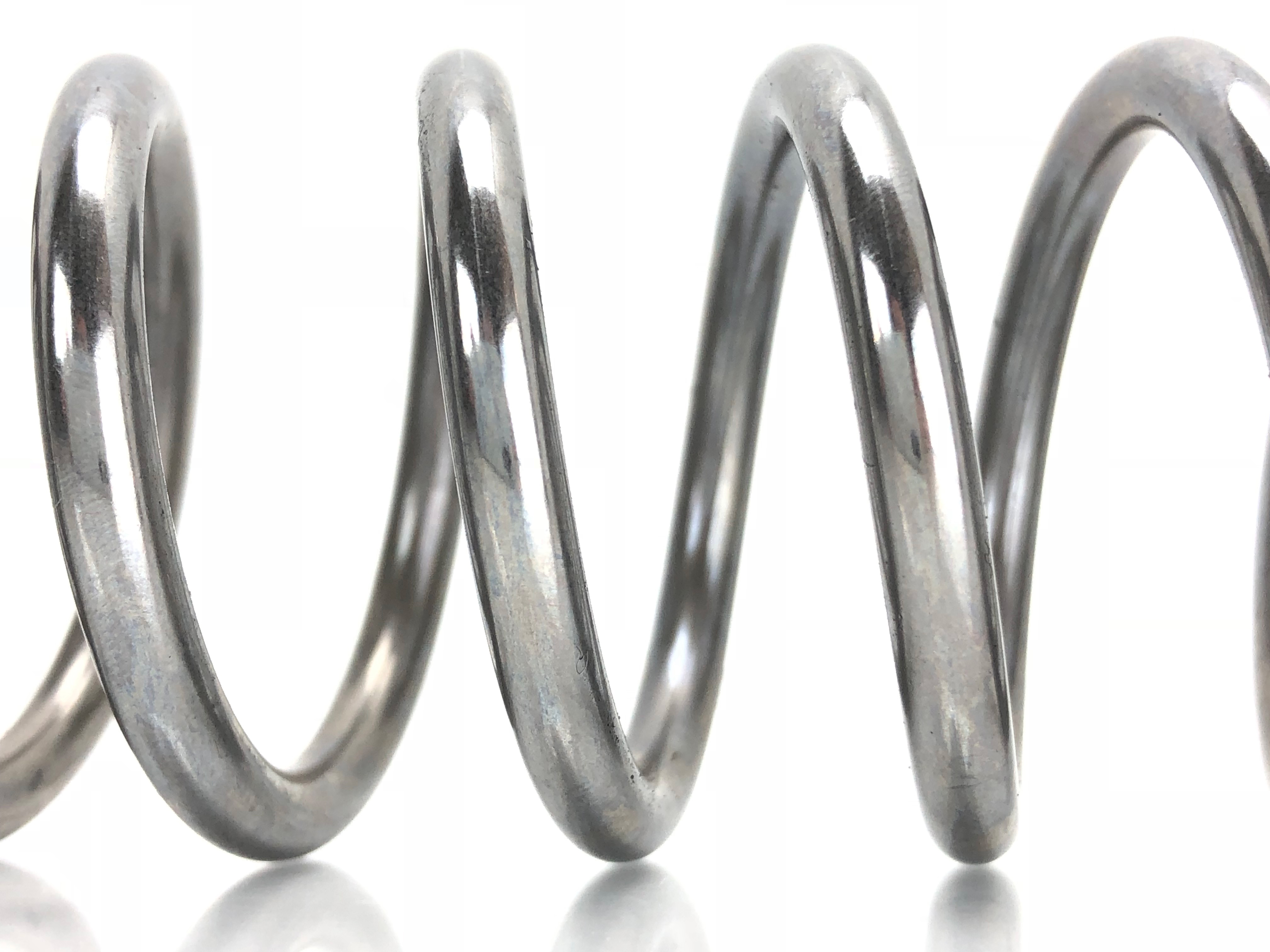 Fork compression spring coils