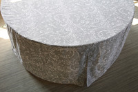 """You've got an amazing sense of style!Bali in gray and white is the perfect fitted table cover for your home, beach house, lake house or any venue in or outdoors for all types of occasions. The fresh feel mimics your favorite poplin cotton top. The new weight is celebration ready straight out of the bag. Wash and reuse for celebrations, home decor or to enhance a special professional event. Our patented fit is one-piece and transforms your 60"""" folding table from so-so to sensational in less than 30 seconds. Great for guest seating, serving or any place you want a classy well-dressed table. Bali, leaves the wash with only minimal air drying time"""