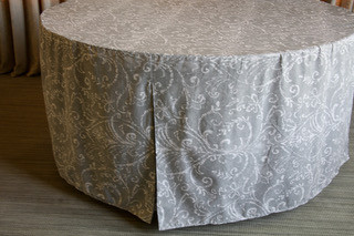 """You've got excellent taste!Bali in gray and white is the perfect fitted table cover for your home, beach house, lake house or any venue in or outdoors for all types of occasions. The fresh feel mimics your favorite poplin cotton top. The new weight is celebration ready straight out of the bag. Wash and reuse for celebrations, home decor or to enhance a special professional event. Our patented fit is one-piece and transforms your 48"""" folding table from so-so to sensational in less than 30 seconds. Great for guest seating, serving or any place you want a classy well-dressed table. Bali, leaves the wash with only minimal air drying time"""