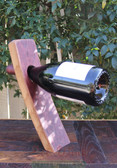 This Wine Bottle Holder elegantly displays a bottle of your favorite wine. What a great conversational piece.