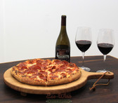 This beautiful platter is made from a single wine barrel head with an extended wooden handle. This is perfect for serving your favorite pizza.