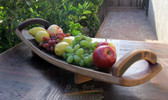 What a unique piece, an all-oak platter with handles has curved, concave design and smooth finish. A great way to serve or display fruit or bread.
