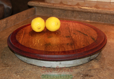 Our Lazy Susan designed to make entertaining and dining more convenient by moving food from one person to another while enjoying your meal. This solid oak Lazy Susan features smooth-rolling ball-bearing turntable and a non-toxic finish that is safe for food use with a beautiful outer rim Red Stain. (Small)