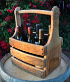 Sturdy oak carrier securely holds six wine bottles for transport and display. Special order not carried in stock. Wine not included.