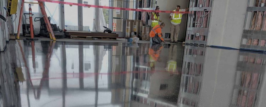 concrete polishing team working on a floor