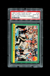 1984 NFL ACTION HIGHLIGHTS FLEER TEAM ACTION #76 LEAP FOR THE BALL CARRIER PSA 10