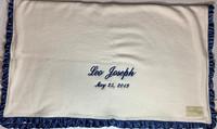 organic blanket with blue silk trim