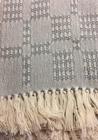 Fringed baby blanket in gray