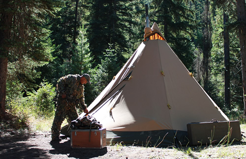 Hunter entering Tentipi tent after morning hunt