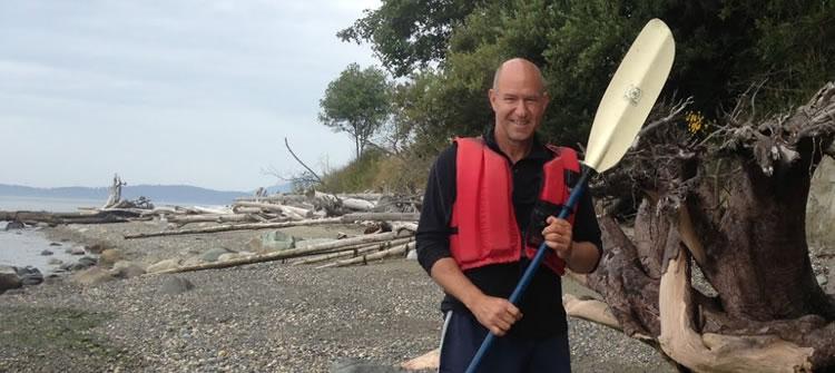 kayak camper toting Tentipi camping gear