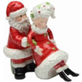 Whimsical Santa holding Mrs. Claus Christmas Salt & Pepper Shakers