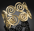Sara - Anju Brass / Gold-tone Swirl Adjustable Cuff Bracelet