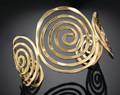 Anju Brass / Gold-tone Swirl Adjustable Cuff Bracelet