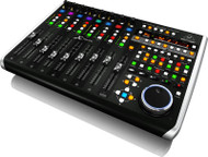 Behringer      Universal Control Surface with 9 Touch-Sensitive Motor Faders, LCD Scribble Strips and Ethernet/USB/MIDI Interface