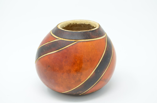 Dark, striped gourd  Hand carved uncured gourd for drinking Wild Harvest Yerba Mate the traditional way. Hot & Strong. We also use it to drink any kine of Green or Black tea (Camilla Sinensis)  Great Unique Gift. Best purchased with a Bamboo Bombilla (Filter Straw)