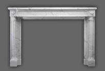 The Versailles Neoclassical style with beautifuly tapered legs on this marble mantel.