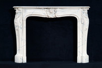 The Louis XIV style marble mantel in carrara marble