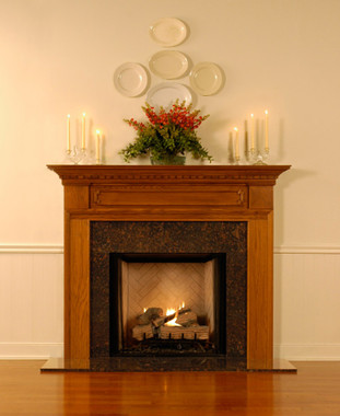 The Hampton fireplace mantel has special design elements on the breast plate.