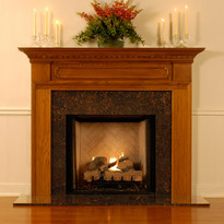 Hampton mantel shown with tan brown granite.