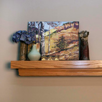 Red Oak with our golden honey finish shown on this fireplace mantel shelf