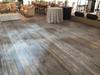 Weathered Cedarwood Paneling, used as flooring