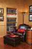 A home library in enriched with a luxurious leather pattern paneling above the wainscoting