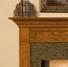 Details like picture frame molding are featured on this fireplace mantel
