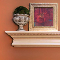 The Manorville Mantel Shelf features embossed egg and dart molding