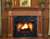 The Princeton custom fireplace mantel has smooth column legs that sit on a square base