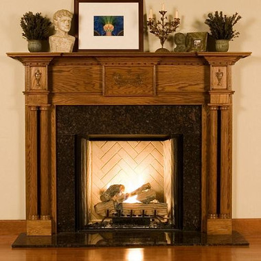 This mantel surround is available in six wood species (including Oak) and various factory finish options.